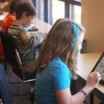 photos of students using devices.