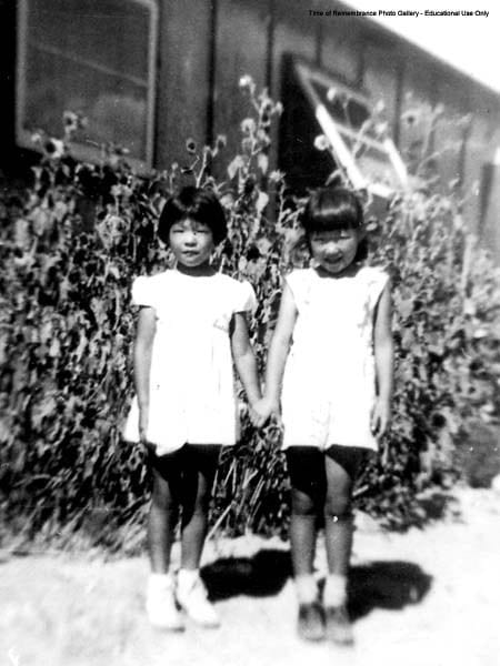 Christine Umeda and friend outside Heart Mountain relocation Center Barrack